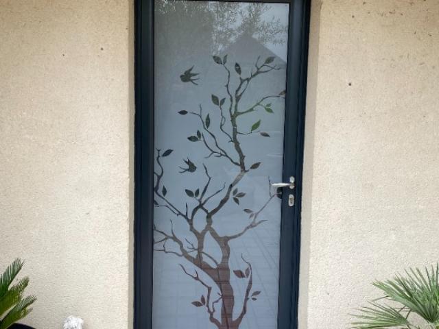 Remplacement d'une porte en bois par une porte alu vitré à St Pierre en Auge